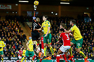 Barnsley goalkeeper Adam Davis (1) clears a corner during the EFL Sky Bet Championship match between Norwich City and Barnsley at Carrow Road, Norwich, England on 18 November 2017. Photo by Phil Chaplin.