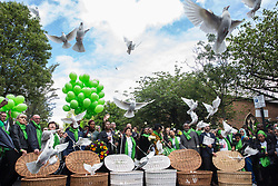 London, UK. 14 June, 2019. Family members release doves of peace following a memorial service at St Helen's Church to mark the second anniversary of the Grenfell Tower fire on 14th June 2017 in which 72 people died and over 70 were injured.