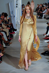© Licensed to London News Pictures. 18/02/2017. London, UK.  A model presents a look by MODAPP (New York) at the UK's first London Modest Fashion Week taking place this weekend at the Saatchi Gallery.  The two day event sees 40 brands from across the world come together to showcase their collections for Muslim and other religious women. Photo credit : Stephen Chung/LNP