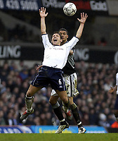 Picture: Henry Browne.<br /> Date: 14/03/2004.<br /> Tottenham Hotspur v Newcastle United FA Barclaycard Premiership.<br /> <br /> Michael Brown of Spurs feels the pain from United's Jermaine Jenas.