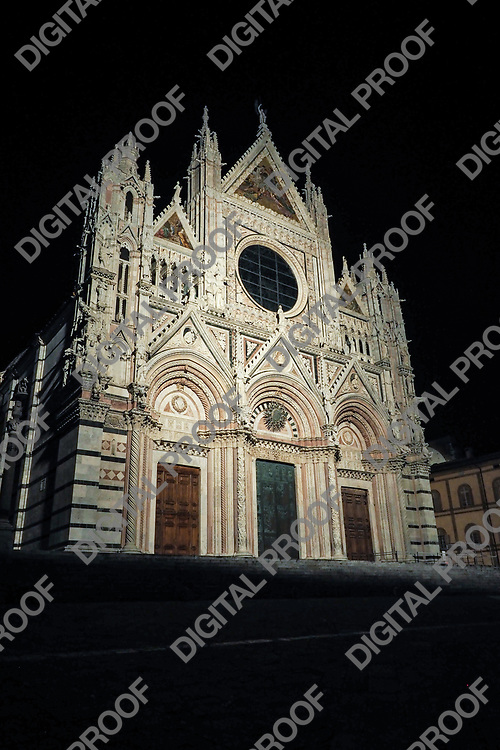 Siena Duomo illuminated at night frontal side view without people around