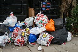 © Licensed to London News Pictures. 28/12/2020. London, UK. Bags of rubbish are gathered in a front garden in London after the festive period. Photo credit: Dinendra Haria/LNP