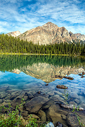 Franchere Peak reflection upon the calm water of Cavell Lake in Jasper National Park