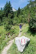 Girl hiking on the trail to Loser, a peak above Altausseer See. Ausseerland, Salzkammergut, Austria © Rudolf Abraham