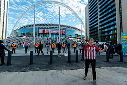 © Licensed to London News Pictures. 18/04/2021. LONDON, UK.  A Southampton supporter outside Wembley Stadium ahead of the FA Cup semi-final match between Leicester City and Southampton.   4,000 local residents have been invited to attend the match, the largest number of spectators attending a match in a UK stadium for over a year.  Covid-19 testing will take before and after the match and data gathered will be used to plan how all sports tournaments can escape lockdown.  Photo credit: Stephen Chung/LNP
