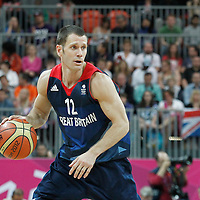 02 August 2012: Great Britain Nate Reinking looks to pass the ball during 79-78 Team Spain victory over Team Great Britain, during the men's basketball preliminary, at the Basketball Arena, in London, Great Britain.