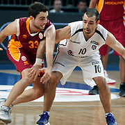 Besiktas's Can Akin (R) and Galatasaray's Ender Arslan (L) during their BEKO Basketball League match Besiktas between Galatasaray at the Sinan Erdem Arena in Istanbul at Turkey on Saturday, December, 17, 2011. Photo by TURKPIX