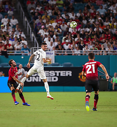 July 31, 2018 - Miami Gardens, Florida, USA - Real Madrid C.F. midfielder Javier Sanchez (32) leaps to head the ball above Manchester United F.C. defender Luke Shaw (23) (left) and midfielder Ander Herrera (21) during an International Champions Cup match between Real Madrid C.F. and Manchester United F.C. at the Hard Rock Stadium in Miami Gardens, Florida. Manchester United F.C. won the game 2-1. (Credit Image: © Mario Houben via ZUMA Wire)