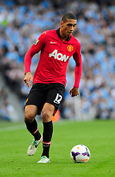 Manchester United's Chris Smalling - Photo mandatory by-line: Dougie Allward/JMP - Tel: Mobile: 07966 386802 22/09/2013 - SPORT - FOOTBALL - City of Manchester Stadium - Manchester - Manchester City V Manchester United - Barclays Premier League