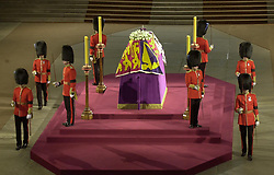 File photo dated 09/04/02 of the flag draped coffin of Queen Elizabeth the Queen Mother, standing in Westminster Hall, London, surrounded by Irish Guardsmen.The Queen mother's funeral was the last royal funeral to be extensively televised in the UK. Issue date: Friday April 16, 2021.