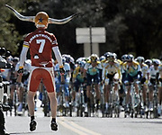 Cycling fan Dory Holte, left, waits for the peloton near Oakurst, Calif., during stage four of the Tour of California cycling race in , Calif., Wednesday, Feb. 18, 2009. (AP Photo/Marcio Jose Sanchez)