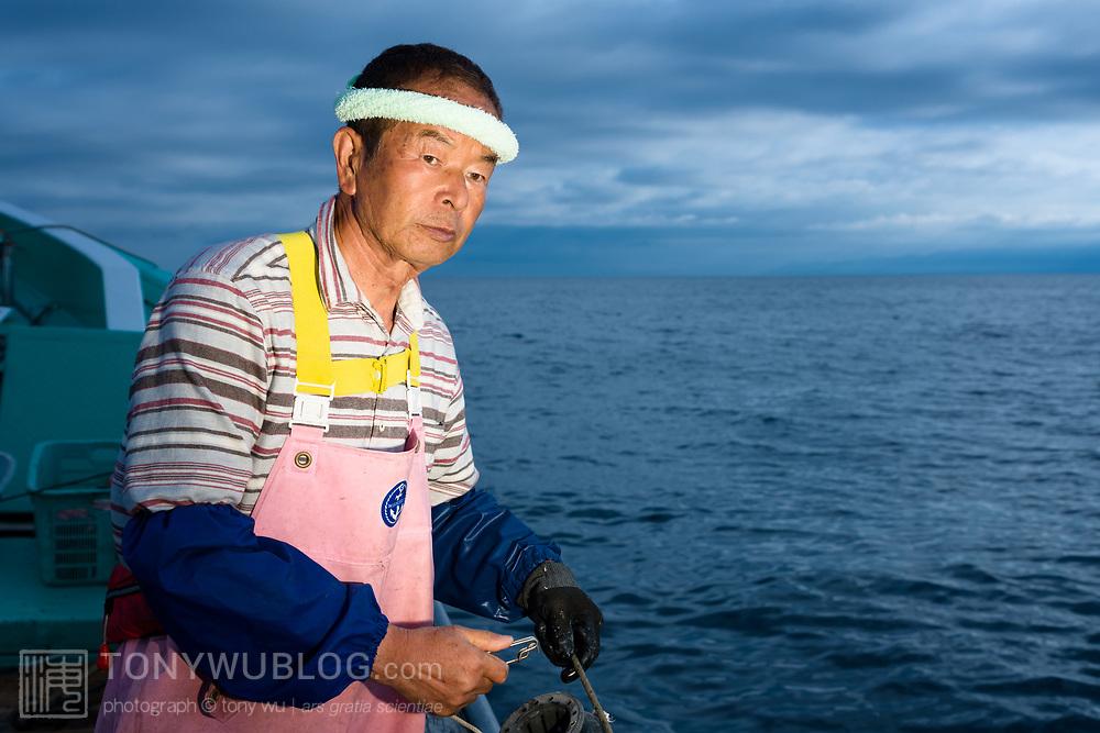 Hasegawa-san setting out fishing lines in the deep waters of Suruga Bay, Japan