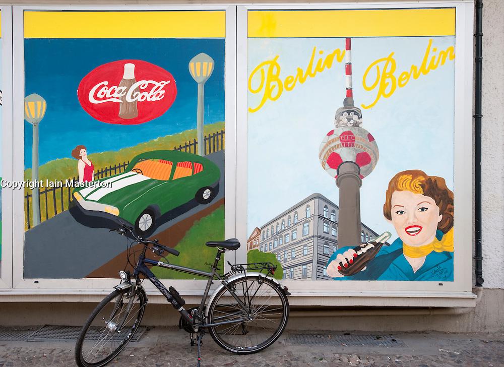 Humorous mural painted on outdoor wall of building in bohemian Prenzlauer BErg district in BErlin Germany