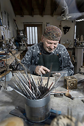 Senior male goldsmith metalworking in workshop, Bavaria, Germany