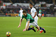 Jonny Evans of West Bromwich Albion is fouled by Wayne Routledge of Swansea city.Premier league match, Swansea city v West Bromwich Albion at the Liberty Stadium in Swansea, South Wales on Saturday 9th December 2017.<br /> pic by  Andrew Orchard, Andrew Orchard sports photography.