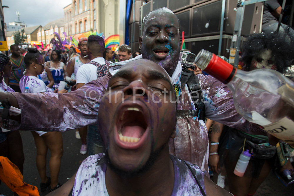 Sunday on 28th August 2016 at Notting Hill Carnival in West London. A celebration of West Indian / Caribbean culture and Europes largest street party, festival and parade. Revellers come in their hundreds of thousands to have fun, dance, drink and let go in the brilliant atmosphere. It is led by members of the West Indian / Caribbean community, particularly the Trinidadian and Tobagonian British population, many of whom have lived in the area since the 1950s. The carnival has attracted up to 2 million people in the past and centres around a parade of floats, dancers and sound systems.