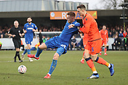 AFC Wimbledon striker Joe Pigott (39) battles for possession with Millwall defender Jake Cooper (5) during the The FA Cup 5th round match between AFC Wimbledon and Millwall at the Cherry Red Records Stadium, Kingston, England on 16 February 2019.