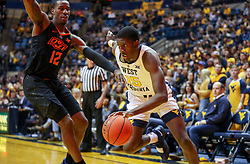 Jan 12, 2019; Morgantown, WV, USA; West Virginia Mountaineers forward Lamont West (15) drives baseline past Oklahoma State Cowboys forward Cameron McGriff (12) during the second half at WVU Coliseum. Mandatory Credit: Ben Queen-USA TODAY Sports
