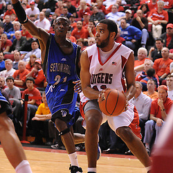 Feb 8, 2009; Piscataway, NJ, USA; Rutgers guard/forward Earl Pettis (11) looks for an open pass against the defense of Seton Hall guard Jeremy Hazell (21) during the second half of Seton Hall's 65-60 victory at the Louis Brown Athletic Center.