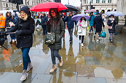 Tourists with umbrellas pass by the Houses of Parliament in Westminster. As forecasters predicted, the rain arrives in London where Londoners and tourists go about their business. London, February 13 2018.