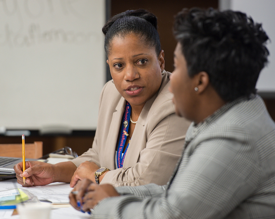 Second-tier teachers participate in a professional development workshop at Henry Middle School, December 11, 2014.