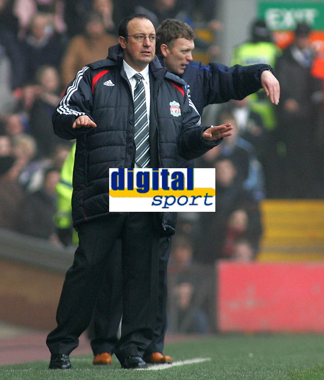 Photo: Paul Thomas.<br /> Liverpool v Everton. The Barclays Premiership. 03/02/2007.<br /> <br /> Managers Rafael Benitez (L) of Liverpool and David Moyes try to get their messages across.