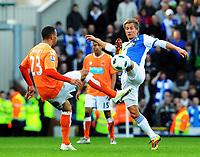 Football - Premier League - Blackburn Rovers vs. Blackpool. Blackburn Rovers Morten Gamst Pederson challenges Blackpool's Matt Phillips  at Ewood Park Stadium, Blackburn<br /> <br /> Norway only