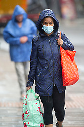 © Licensed to London News Pictures 04/06/2021. Sidcup, UK. No more sunny weather today as the rain makes a comeback in South East London as people in Sidcup High Street get wet. Photo credit:Grant Falvey/LNP
