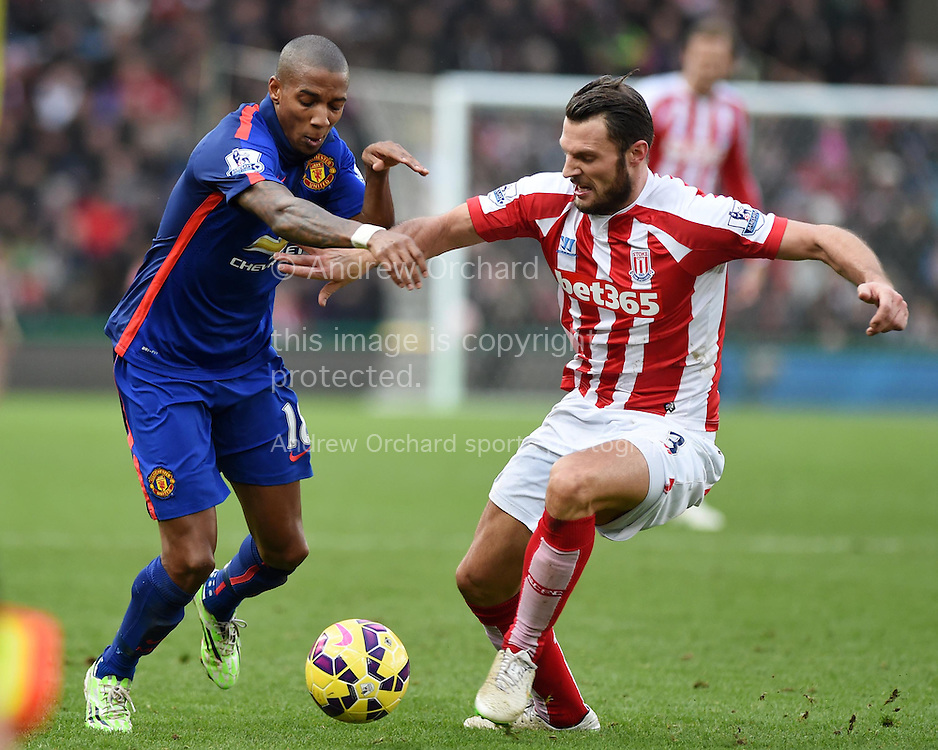 Erik Pieters of Stoke city challenges Ashley Young of Man Utd. Barclays Premier league match, Stoke city v Manchester Utd at the Britannia Stadium in Stoke on Trent, Staffs on New Years Day , Thursday 1st Jan 2015. pic by Andrew Orchard. Andrew Orchard sports photography.