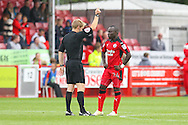Referee Gavin Ward shows yellow card to Crawley Town Midfielder Aliu Djalo during the EFL Sky Bet League 2 match between Crawley Town and Luton Town at the Checkatrade.com Stadium, Crawley, England on 17 September 2016. Photo by Phil Duncan.