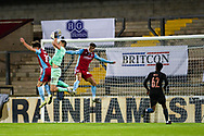 James Trafford of Man City u21 Aaron Jarvis (19) of Scunthorpe United   John McAtee (45) of Scunthorpe United battles for possession with during the EFL Trophy match between Scunthorpe United and Manchester City at Glanford Park, Scunthorpe, England on 29 September 2020.