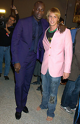 Left to right, OZWALD BOATENG and SAM BRANSON at a fashion show and after party to celebrate the 20th Anniversay of fashion designer Ozwald Boateng held at the Victoria & Albert Museum, London on 25th November 2005.<br /><br />NON EXCLUSIVE - WORLD RIGHTS