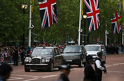 © Licensed to London News Pictures. 05/06/2012. London, Britain. Prince Charles, Camilla, Duchess of Cornwall and Prince Harry leaving the Buckingham Palace  during the Carriage Procession from Westminster Hall to Buckingham Palace in London, 05 June 2012. The British Royal Family's procession followed  a national service of thanksgiving at St Paul's Cathedral, a reception at Guildhall and a lunch at Westminster Hall. This is the final day of the Diamond Jubilee weekend celebrating Queen Elizabeth II's 60 years on the throne. Great Britain is celebrating the 60th  anniversary of the countries Monarch HRH Queen Elizabeth II accession to the throne this weekend Photo credit : LNP