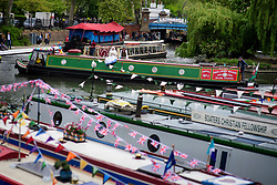© Licensed to London News Pictures.30/04/2017.London, UK. A narrow boat makes it's way along the Regents Canal as the Canalway Cavalcade festival takes place in Little Venice, London on Saturday, 30 April 2017. Inland Waterways Association's annual gathering of canal boats brings around 130 decorated boats together in Little Venice's canals on May bank holiday weekend. Photo credit: Ben Cawthra/LNP