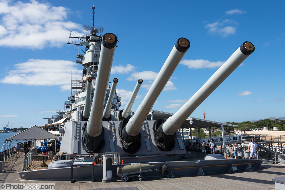 """1944 USS Missouri: main gun battery. Pearl Harbor, Oahu, Hawaii, USA. Ordered in 1940 and active in June 1944, the USS Missouri (""""Mighty Mo"""") was the last battleship commissioned by the United States. She is best remembered as the site of the surrender of the Empire of Japan which ended World War II on September 2, 1945 in Tokyo Bay. In the Pacific Theater of World War II, she fought in the battles of Iwo Jima and Okinawa and shelled the Japanese home islands. She fought in the Korean War from 1950 to 1953. Decommissioned in 1955 into the United States Navy reserve fleets (the """"Mothball Fleet""""), she was reactivated and modernized in 1984 and provided fire support during Operation Desert Storm in January-February 1991. The ship was decommissioned in March 1992. In 1998, she was donated to the USS Missouri Memorial Association and became a museum at Pearl Harbor on the island of Oahu."""