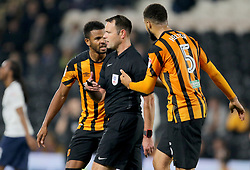 Hull City's Fraizer Campbell (left) and Hull City's Michael Hector complain to the referee James Linnington