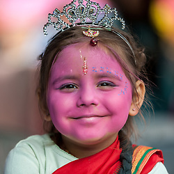 © Licensed to London News Pictures. 05/09/2015. Watford, UK. Kishori, aged 4, wears a crown and pink face-paint with gopi dots during her visit to the biggest Janmashtami festival outside of India at the Bhaktivedanta Manor Hare Krishna Temple in Watford, Hertfordshire.  The event celebrates the birth of Lord Krishna and the festival  includes music, dance, food, dramas and more. Photo credit : Stephen Chung/LNP
