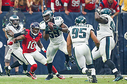 Philadelphia Eagles inside linebacker DeMeco Ryans #59 intercepts a pass during the NFL game between the Philadelphia Eagles and the Houston Texans at NRG Stadium in Houston, Texas on Sunday November 2nd 2014. The Eagles won 31-21. Ryans subsequently fumbled the ball and injured his Achilles tendon on the play. (Brian Garfinkel/Philadelphia Eagles)