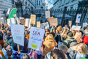 Outside the gates of Downing Street - School students go on strike over the lack of action on climate change. They gather in Parliament square and march on Downing Street, blocking the streets around westminster for over an hour.