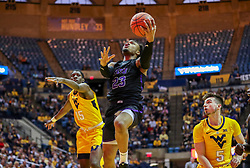 Mar 20, 2019; Morgantown, WV, USA; Grand Canyon Antelopes guard Carlos Johnson (23) shoots in the lane during the first half against the West Virginia Mountaineers at WVU Coliseum. Mandatory Credit: Ben Queen