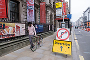 Scene at Piccadilly where very few people or vehicles are out and about as the national coronavirus lockdown three continues on 3rd March 2021 in London, United Kingdom. With the roadmap for coming out of the lockdown has been laid out, this nationwide lockdown continues to advise all citizens to follow the message to stay at home, protect the NHS and save lives, and the streets of the capital are quiet and empty of normal numbers of people.