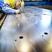 TATA Steel Park Wednesfield - Automotive Service Centre Inspecting precision steel car parts