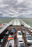 View of vehicles on the deck of the BC Ferries vessel Queen of Alberni.  Photographed in the Salish Sea between the Southern Gulf Islands and Tsawwassen, British Columbia, Canada.