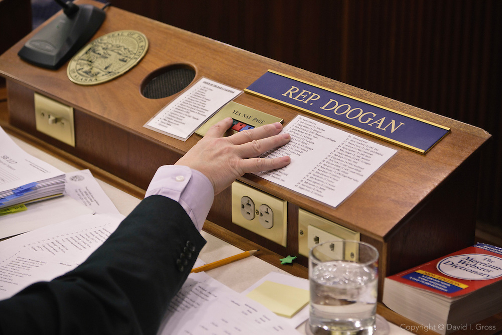 Rep. Mike Doogan votes in the Alaska State House of Representatives.