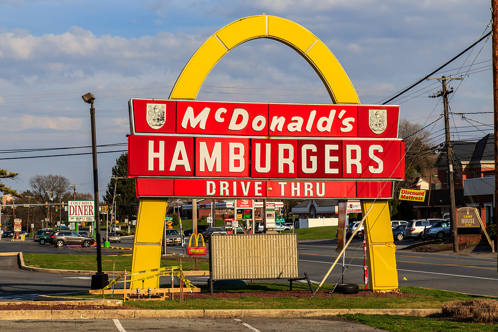 Lancaster, PA / USA - March 25, 2016:  An early McDonald's sign from the 1960's, the large golden arches dates back to early days of the hamburger restaurants.