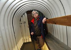 © Licensed to London News Pictures. 04/04/2012. London, UK. Gloria Sachs was eleven when she was evacuated from London to Cambridge for the duration of the war. She is pictured standing in an Anderson  Air Raid Shelter. Photo call and preview for the Imperial War Museums new A Family in Wartime exhibition. The exhibition features the life on the Home Front during the Second World War, explored through the eyes of one London based family, the Allpress. Photo credit : Stephen SImpson/LNP