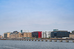 Offices and apartment buildins on Osthafen , East Harbour along River Spree in Berlin , Germany