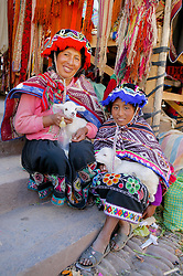 Women With Lambs At Pisco Market