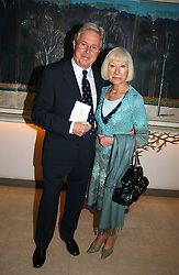 MICHAEL ASPELL and IRENE CLARK at the Lady Taverners Tribute lunch in honour of Ronnie Corbett held at The Dorchester Hotel, Park Lane, London on 3rd November 2006.<br /><br />NON EXCLUSIVE - WORLD RIGHTS