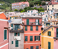 A resident looks out her window over the village of Vernazza, in Cinque Terre on the Ligurian coast of Italy